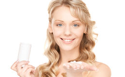 Young woman with pills Royalty Free Stock Images