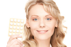 Young woman with pills Stock Image