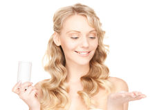 Young woman with pills Stock Images