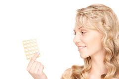 Young woman with pills Royalty Free Stock Photography
