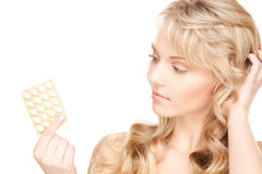Young woman with pills Royalty Free Stock Photo