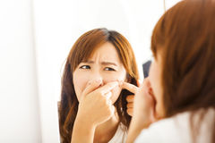 Young  woman with pimple on her face Stock Photo