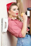 Young woman with a pin-up look Royalty Free Stock Photos