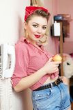 Young woman with a pin-up look Stock Photo