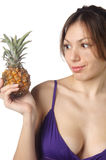 Young woman with pineapple Royalty Free Stock Photography
