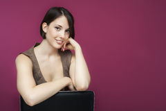 Young woman on pink background. Royalty Free Stock Photography