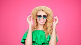Young woman on a pink background with sunglasses. Happy Young woman on a pink background with sunglasses stock video