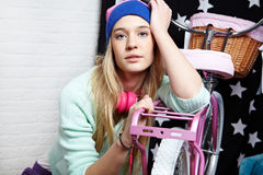Young woman with pink  bike Royalty Free Stock Image