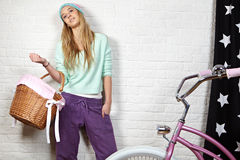 Young woman with pink  bike Stock Photography