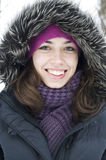 The young woman in a pink cap and a hood is happy Royalty Free Stock Photo