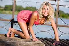 The young woman in pink clothes. Stock Photography