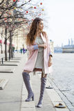 Young woman in pink coat walks on the Red Square in Moscow Stock Photography