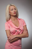 Young woman in pink costume Stock Photography