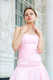 Young woman in pink dress Stock Images