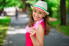 Young woman in pink dress at green summer park Stock Photos