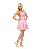 Young woman in pink dress and high heels. Beauty, fashion and happy people concept - young woman in pink dress and high heels Stock Images