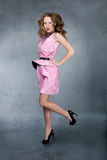 Young woman in pink dress, jumps up Stock Photos