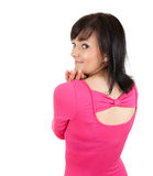 Young woman in pink dress looking Stock Photography