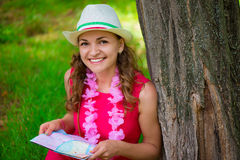 Young woman in pink dress with map at green summer park Stock Photography