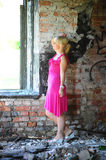 Young woman in pink dress among the ruins Stock Images