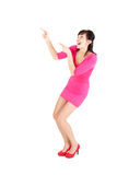 Young woman in pink dress showing up Royalty Free Stock Image