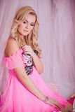 Young woman in pink fashion clothes Stock Photo