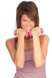 Young woman with pink fitness weights Stock Photography