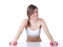 Young woman with pink fitness weights Royalty Free Stock Images