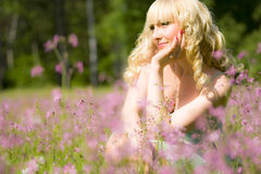 Young woman in pink flowers Stock Photo
