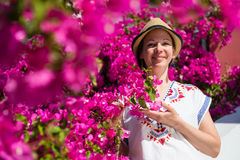 Young woman and pink flowers Royalty Free Stock Photos