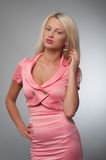 Young woman in pink glamour costume. Young blond woman in pink glamour costume Stock Image