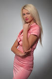 Young woman in pink glamour costume Stock Images