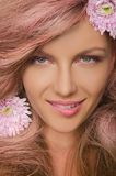 Young woman with pink hair and flowers Royalty Free Stock Photo