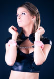 Young woman with pink handcuffs stock image