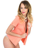 Young Woman Pink Jacket and Lingerie Royalty Free Stock Photography