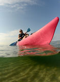 Young woman in pink kayak Royalty Free Stock Photo