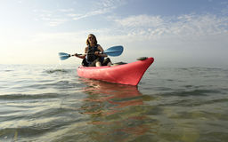 Young woman in pink kayak Royalty Free Stock Images
