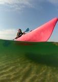 Young woman on pink kayak Stock Photography
