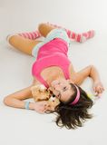 Young woman in pink lay with toy Stock Photography