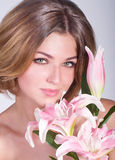 young woman with pink lily Stock Photo