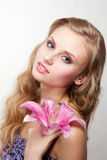 Young woman with pink lily stock image