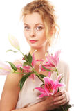 Young woman with pink lily Royalty Free Stock Photos