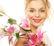 Young woman with pink lily Royalty Free Stock Images