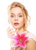 Young woman with pink lily Stock Photography