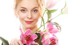 Young woman with pink lily Royalty Free Stock Photography
