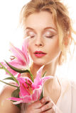 Young woman with pink lily Stock Photos