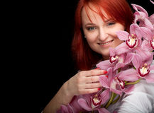 Young woman with pink orchid Stock Image