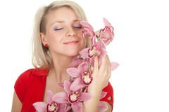 Young woman with pink orchid Stock Images
