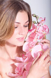 Young woman with pink orchid Stock Photography