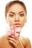 Young woman with pink orchid Stock Photo